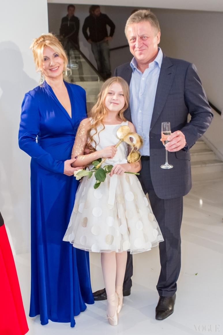 Оксана и Игорь Лысовы с дочерью