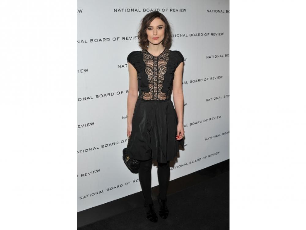 В платье Nina Ricci