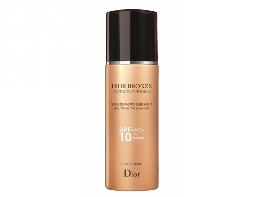Сухое масло Dior Bronze Voile de Mono? Sublimant Body SPF10, Dior. Легкое масло тает на коже и пахнет экзотическими цветами Маркизских островов. Подходит для загоревшей или смуглой кожи