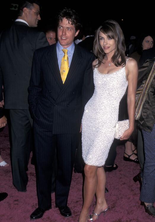 Хью Грант и Элизабет Херли на премьере фильма «Остин Пауэрс: Человек-загадка международного масштаба», 1997