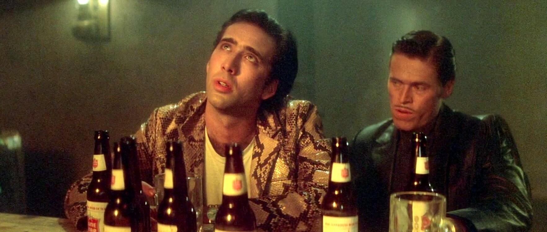 Ніколас Кейдж та Віллем Дефо у фільмі «Дикі серцем», 1990