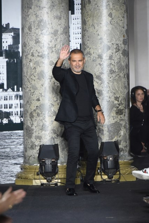 Elie Saab greets his audience in Paris after his Autumn/Winter 2016 Couture presentation
