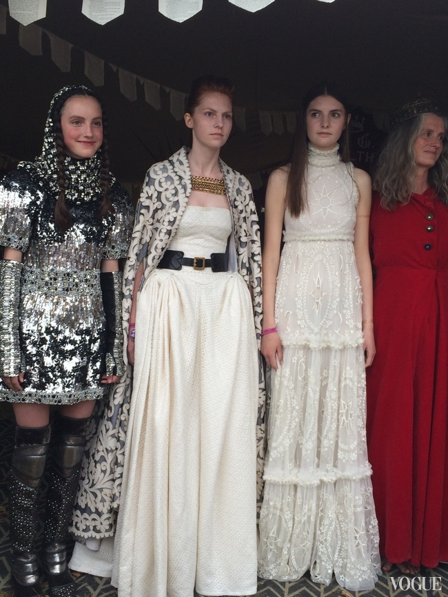 Members of the audience model in the medieval fashion show. Dolce & Gabbana's mediaeval armour-inspired dress is on the far left