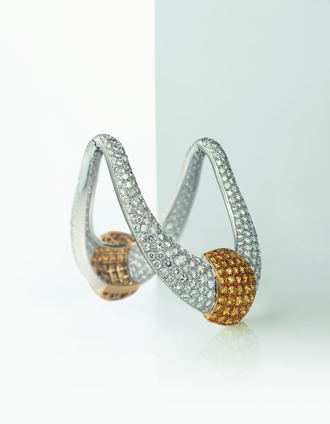 An armlet crafted in platinum and yellow gold with white and jonquille pav? diamonds