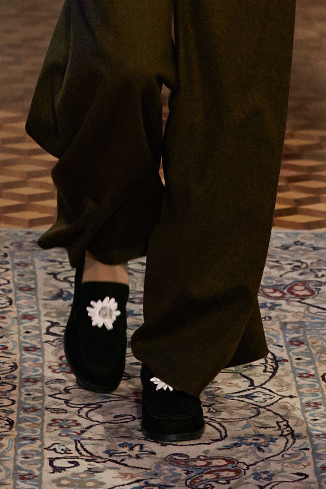 Loafers in Look 18  are embroidered with white leather edelweiss, white chenille yarns and small glitter balls by embroiderer Montex