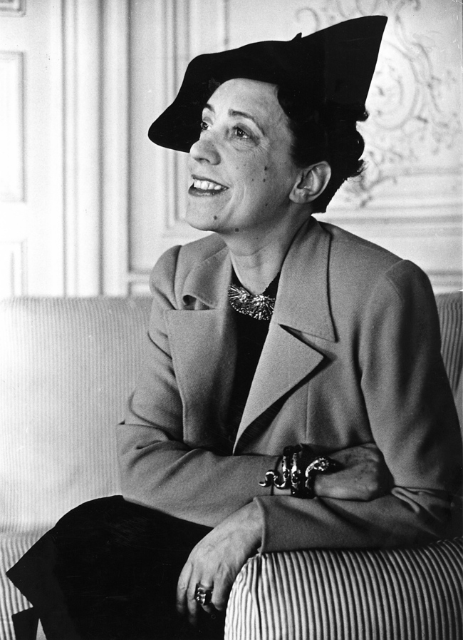 "Elsa Schiaparelli wearing a jacket of her new magenta colour known as ""shocking"""