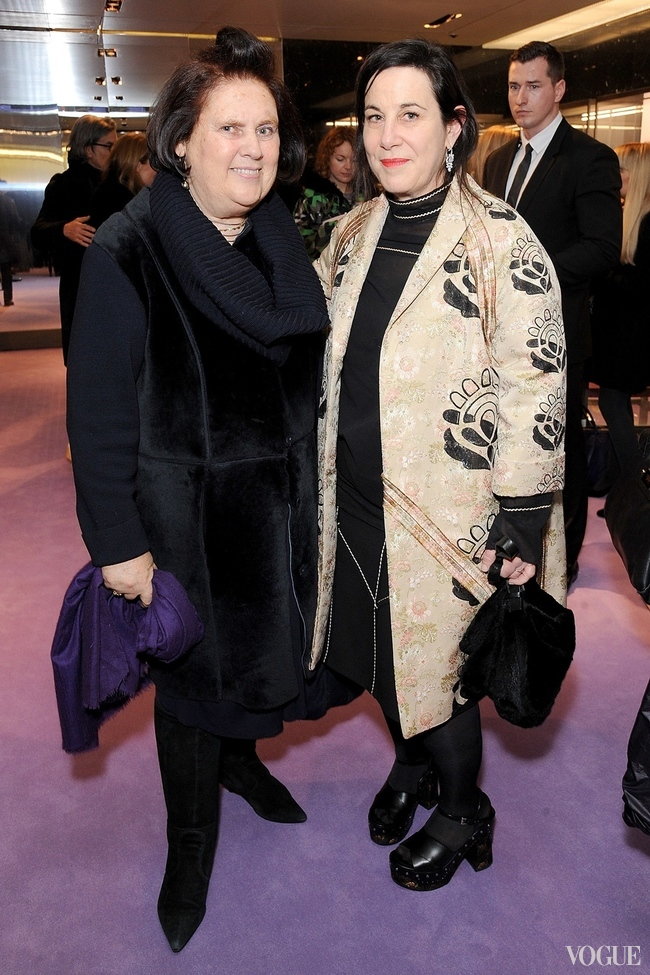 "Suzy Menkes with Arianne Phillips (right, wearing Prada) at Prada's ""The Iconoclasts"" installation in London last February"
