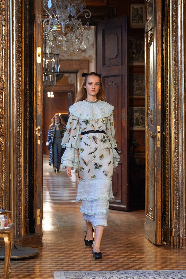 """Handwork for look 50. Dress: 800 hours of work by embroiderer Lesage. Butterflies, peacocks and cockerel feathers  are embroidered with a """"luneville"""" hook, using 86,000 sequins and micro-beads. Then feathers are added using needlework embroidery"""
