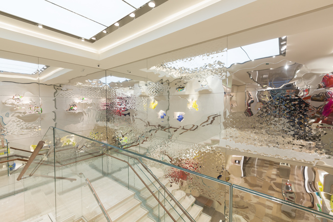 The new Longchamp flagship on Paris' Champs-Elys?es with Cloud Illusions art on the walls by Danish artist Astrid Krogh
