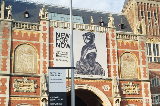 The banner for the New for Now exhibition, displayed on the facade of Amsterdam's Rijksmuseum