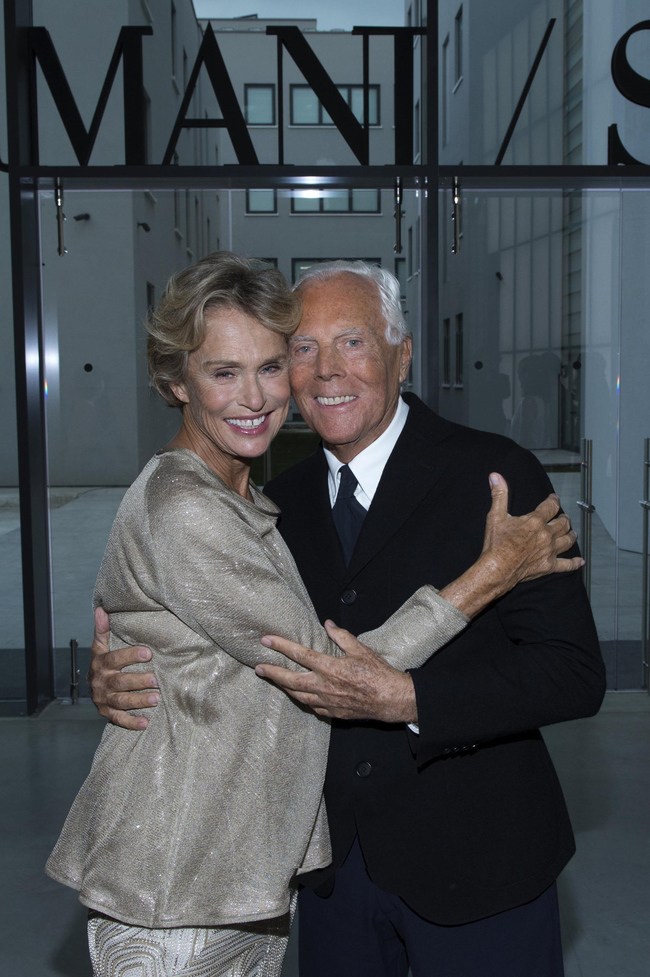 Lauren Hutton and Giorgio Armani pose in the doorway of his Silos