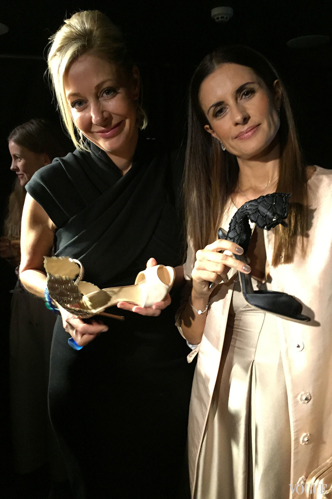 Nadja Swarovski and Livia Firth admire the shoes