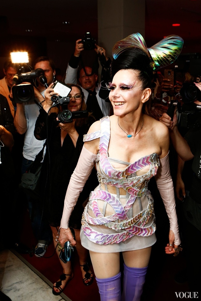 Susanne Bartsch posing for the paparazzi at the party for her exhibition at FIT last night