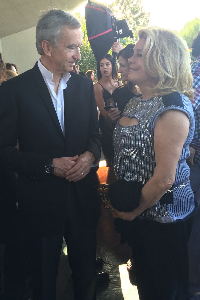 Bernard Arnault, chairman and CEO of LVMH, catches up with Catherine Deneuve