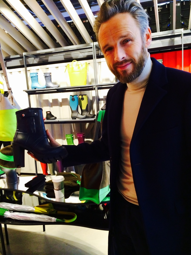 Alasdhair Willis, Hunter's creative director, with a pair of platform wellington boots in his first Hunter global flagship store on London's Regent Street