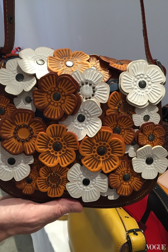 Leather applique flowers on a Coach spring-summer 2016 handbag