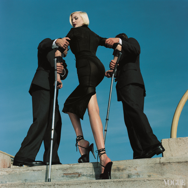High and Mighty shoot, American Vogue, February 1995. Model Nadja Auermann. Suit Dolce & Gabbana, 1995. CREDIT  © Estate of Helmut Newton Maconochie Photography