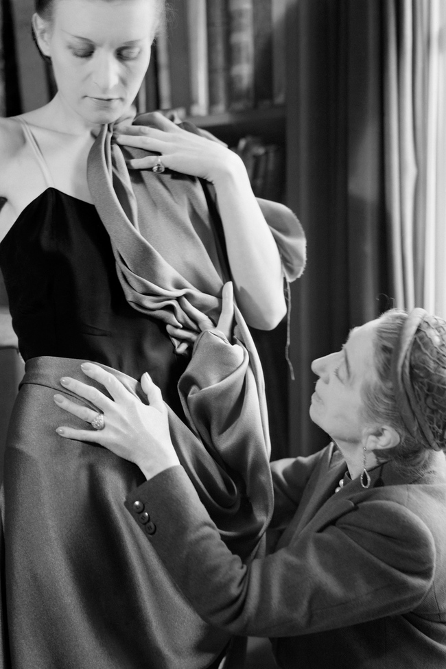 Jeanne Lanvin draping fabric on a model