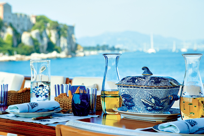 T.M. Blue One ( Mr. Valentino's yacht); Tureen from a reproduction porcelain dinner service set, after an 1820 Torquay design, Staffordshire; tumblers from a set of sixteen Ralph Lauren crystal tumblers with vertical blue stripes