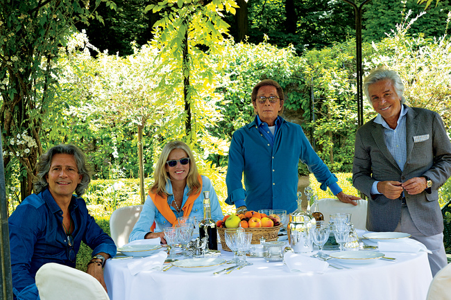 Wideville. A casual lunch is set under the garden gazebo. Left to right: Carlos Souza, Charlene Shorto, Valentino Garavani, and Giancarlo Giammetti