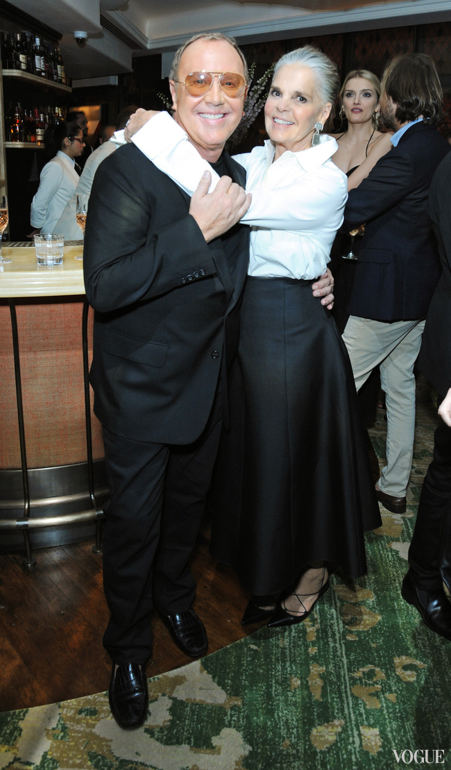 Panellists Michael Kors and Ali MacGraw embrace at the after-party dinner
