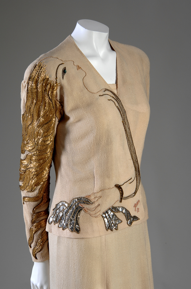An example of Elsa Schiaparelli's surrealist approach to design. A silk-cr?pe and metallic evening ensemble embroidered with a woman's head from Elsa Schiaparelli's collaboration with Jean Cocteau